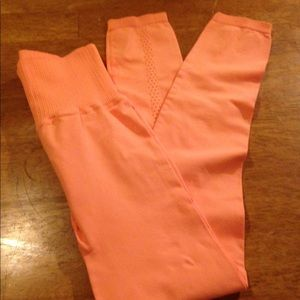 NWOT Tangerine Free People Movement Leggings.